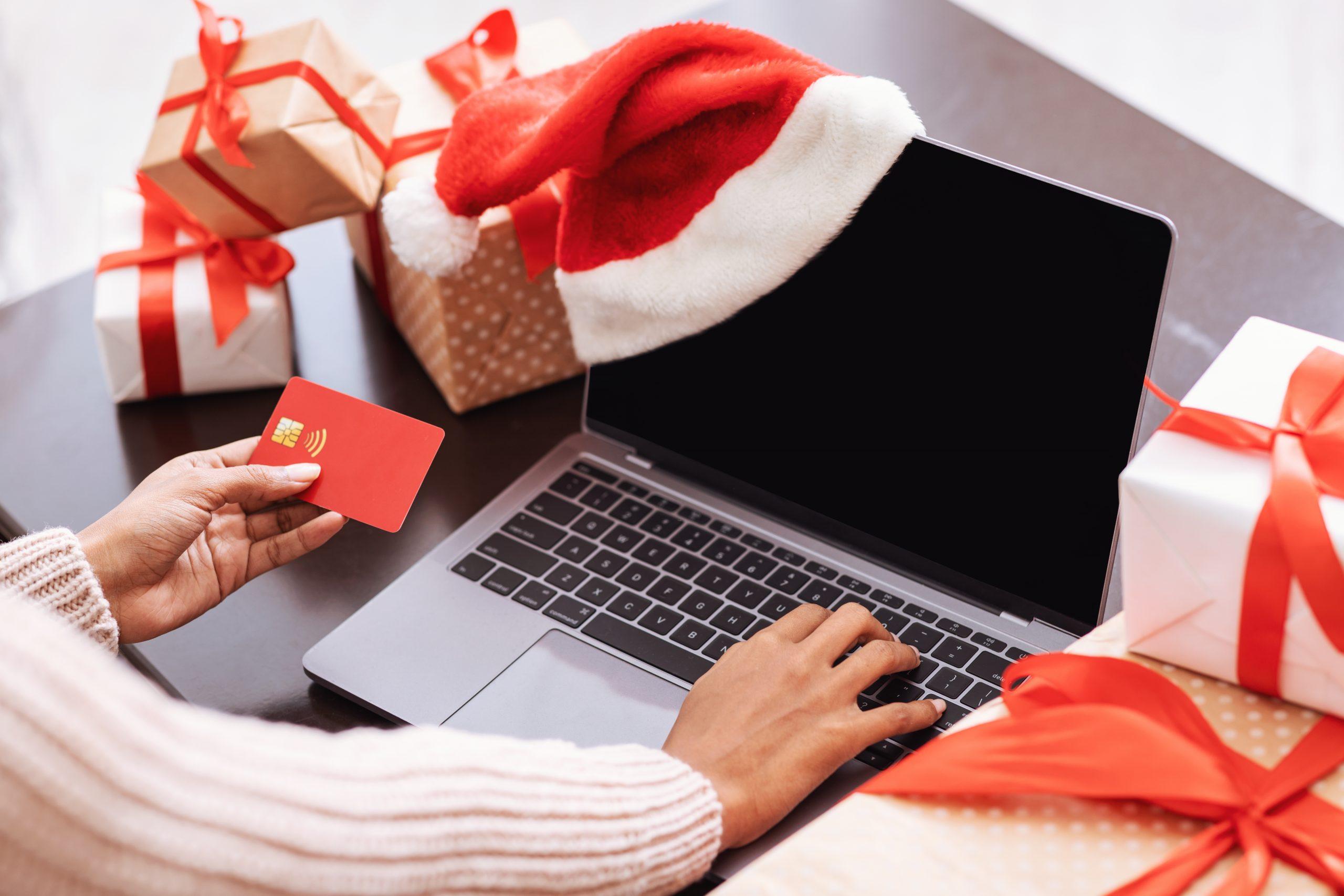xmas shopping black lady using laptop and credit c 4J9E3KT scaled